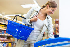 Beautiful young woman shopping in a supermarket Royalty Free Stock Photography