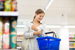 Beautiful young woman shopping in a supermarket Stock Image