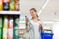 Beautiful young woman shopping in a supermarket Stock Photo