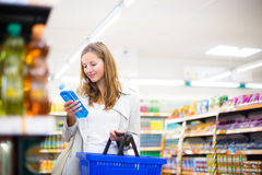 Beautiful young woman shopping in a supermarket Royalty Free Stock Photo