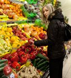 Beautiful young woman shopping vegetables Stock Image