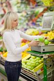 Beautiful young woman shopping for vegetables Stock Photography