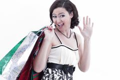 Beautiful young woman with shopping. on white. Background Stock Photos