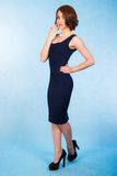 Beautiful young woman in a short blue dress Stock Photography