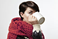 Beautiful young woman with a short brown hair. Hold a white cup of tea or coffee. Look to camera Royalty Free Stock Photography
