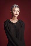 Beautiful young woman with short grey hair stock photos