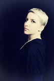 Beautiful young woman with short hair Stock Photography