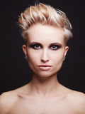 Beautiful young woman with short haircut Stock Image