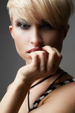 Beautiful young woman with short haircut Stock Photos