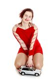 Beautiful young woman in short red dress plays Stock Images