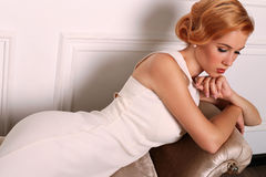 Beautiful young woman with short red hair in retro style,wears elegant white dress Royalty Free Stock Photos