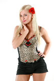 Beautiful young woman in shorts with rose in hair Royalty Free Stock Photography