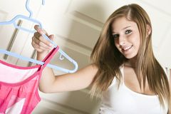 Beautiful young woman show is clothe Stock Image