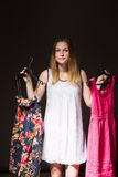 Beautiful young woman show is clothe Stock Images