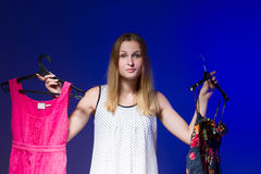 Beautiful young woman show is clothe Stock Photo