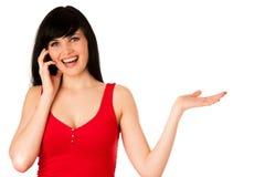 Beautiful young woman showing into copyspace Stock Photo