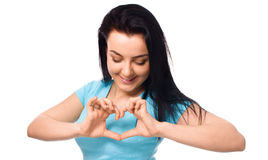 Beautiful young woman showing heart symbol gesture Stock Photography