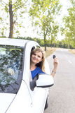 Beautiful young woman showing her car keys. Outdoors Stock Photography