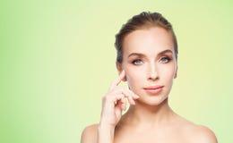 Beautiful young woman showing her cheekbone Stock Image