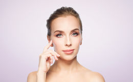 Beautiful young woman showing her cheekbone Royalty Free Stock Photos