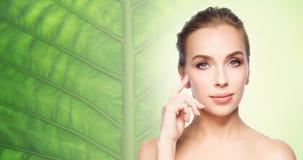 Beautiful young woman showing her cheekbone Stock Photo