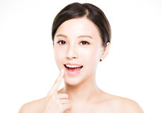 Beautiful young woman showing her teeth Royalty Free Stock Images