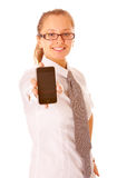 Beautiful young woman showing a mobile phone with Stock Image