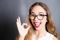 Beautiful young woman showing Ok sign Royalty Free Stock Image