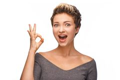 Beautiful young woman showing ok sign Royalty Free Stock Images