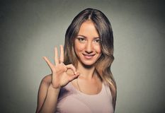 Beautiful young woman showing Ok sign Royalty Free Stock Photography