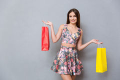 Beautiful young woman showing peace sign and smiling Royalty Free Stock Photography
