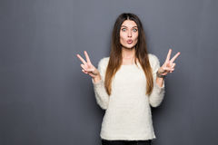 Beautiful young woman showing peace victory sign Royalty Free Stock Photo