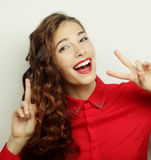 Beautiful young woman showing thumbs up gesture Stock Photography