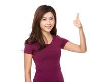 Beautiful young woman showing thumbs up gesture Royalty Free Stock Image