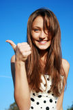 Beautiful young woman showing thumbs up si Royalty Free Stock Images