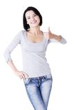 Beautiful young woman showing thumbs up sign Royalty Free Stock Images