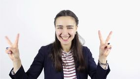 Beautiful young woman showing victory sign and smiling. On white Background stock video