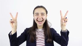 Beautiful young woman showing victory sign and smiling. On white Background stock video footage