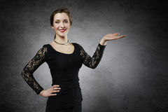 Beautiful young woman showing your product Stock Photography