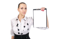Beautiful young woman shows a blank clipboard royalty free stock photo