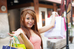 Beautiful young woman shows an ecstatic expression while holding Royalty Free Stock Image