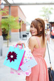 Beautiful young woman shows an ecstatic expression while holding Stock Images