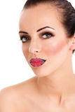Beautiful young woman with shugar red lips Royalty Free Stock Photography