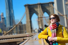 Beautiful young woman sightseeing on Brooklyn Bridge, New York Stock Photos