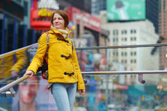 Beautiful young woman sightseeing at Times Square Royalty Free Stock Image