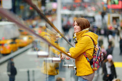 Beautiful young woman sightseeing at Times Square Stock Photos