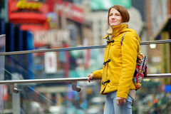 Beautiful young woman sightseeing at Times Square Royalty Free Stock Photography