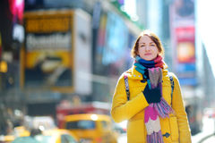 Beautiful young woman sightseeing at Times Square Royalty Free Stock Photos