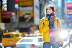 Beautiful young woman sightseeing at Times Square Stock Images