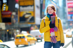 Beautiful young woman sightseeing at Times Square, New York Stock Images
